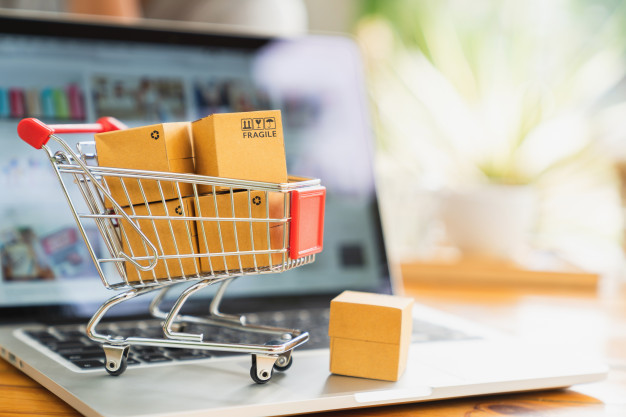 online-shopping-delivery-concept-product-package-boxes-cart-laptop_38716-162